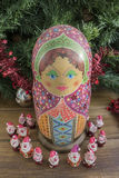Painted wooden matrioshka doll  and Santa Clauses  from modeling clay. Santa Clauses  around   matrioszka doll Royalty Free Stock Image