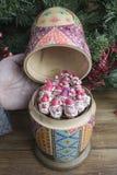 Painted wooden matrioshka doll  and Santa Clauses  from modeling clay. Hand opens matrioshka  doll  with Santa Clauses Royalty Free Stock Photos