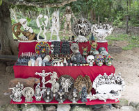 Painted wooden Mayan masks for sale in Chichen Itza. Pictured are various Mayan themed items for sale in Chichen Itza.  Chichen Itza is a pre-Columbian city Royalty Free Stock Photo