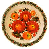 Painted wooden plate on white Royalty Free Stock Photography