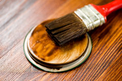 Painted wooden surface. Varnishind natural wood with paint brush Royalty Free Stock Image
