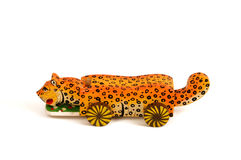Painted wooden toy shaped leopard. Classic homemade wooden isolated on white stock photo