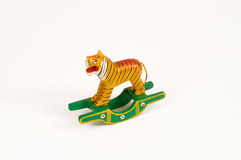 Painted wooden toy shaped like a tiger. Classic homemade wooden isolated on white royalty free stock image