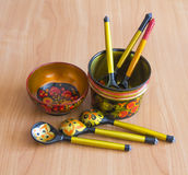 Painted wooden. Ware is on the table Royalty Free Stock Photos