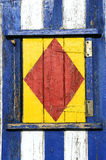Painted wooden window. Fishing hut, detail of painted wooden window Stock Photo