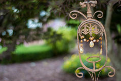 Painted Wrought Iron and Crystal Decor. An outdoor decoration made of wrought iron and crystals sets the stage for a summer wedding at a bed and breakfast royalty free stock photos