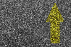 Painted Yellow Arrow Royalty Free Stock Photography