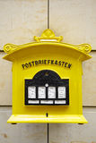 Painted yellow mailbox in Dresden Stock Photography