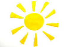 Painted Yellow Sun Of Plasticine On Background Royalty Free Stock Photos