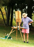 Painter. Artist painting outdoor Stock Images