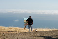 Painter. Artist painting outdoor royalty free stock photography