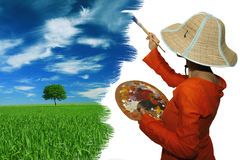 Painter. Young woman paints the landscape i royalty free stock photos