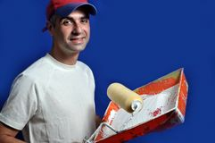 Painter. This picture represents a painter holding a roller and tray Stock Photo
