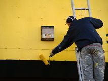 Painter. Construction worker -painter paint wall Royalty Free Stock Photography