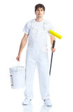 Painter. Young painter man in white suit. Isolated over white background Royalty Free Stock Images