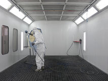 Painter. The image of painter works in a spray booth Stock Image