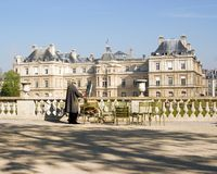 The Painter. Man painting in front of the Palais du Luxembourg, Paris, France Royalty Free Stock Images