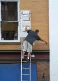 Painter. Man painting a building royalty free stock image