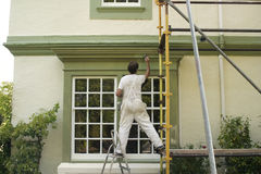 Painter. Decorating a house exterior Stock Images