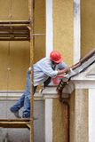 Painter. A worker painting trim Royalty Free Stock Image