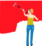 Painter. Woman painting on wall using paint roller Royalty Free Stock Photos