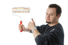 Painter. Holding a paint roller and thumb up Stock Photography