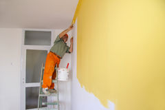 Painter in action. Interior decoration Stock Photo