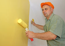 Painter in action Stock Photos
