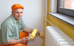 Painter in action Stock Image