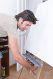 Painter adjusting the easel Stock Photography
