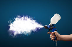 Painter with airbrush gun and white magical smoke Royalty Free Stock Photo
