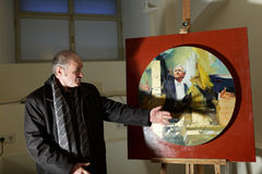 Painter Anatoly Chernykh with his painting Stock Photos