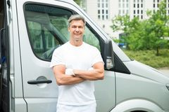 Painter With Arms Crossed In Front Of Van. Happy Male Painter With Arms Crossed Standing In Front Of Van Royalty Free Stock Photo