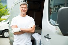Painter With Arms Crossed In Front Of Van Stock Photography