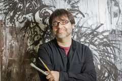 Painter artist posing in front of paint stock images