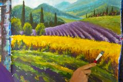 Art creative process. Artist create painting Italian summer countryside. Tuscany. Field of red poppies, a field of yellow rye. Rur. Painter artist draw with stock photo