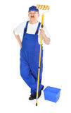 Painter in blue dungarees Stock Photos
