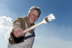 Painter with brush. Painter with a brush in his hand Royalty Free Stock Images