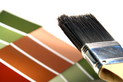 Painter Brush and Design Paint Color Swatches Stock Photography