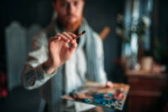 Painter with brush in hand selective focus royalty free stock photo