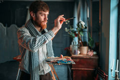 Painter with brush in hand selective focus Royalty Free Stock Images