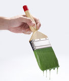 PAINTER BRUSH WITH HAND Royalty Free Stock Photography