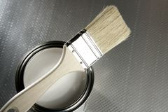 Painter brush and white paint tin. Macro over silver pattern background Royalty Free Stock Images
