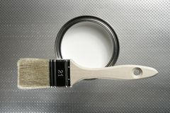 Painter brush and white paint tin. Macro over silver pattern background Stock Images