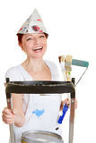 Painter with brushes and ladder. Happy female painter with brushes and ladder and paint buckets Royalty Free Stock Photo