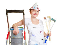 Painter with brushes and paint. Buckets and ladder Stock Images
