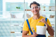 The painter with bucket of paint in workshop Stock Image