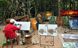 Painter at Cambodia. A painter drawing relics at one of the temples in Siem Reap, Cambodia. A common view at the most of temples, where local artists are Stock Images