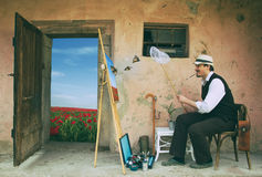 Painter is Catching a Butterflies Royalty Free Stock Photo