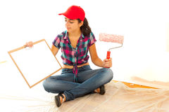 Painter with clipboard and roll brush Stock Photography